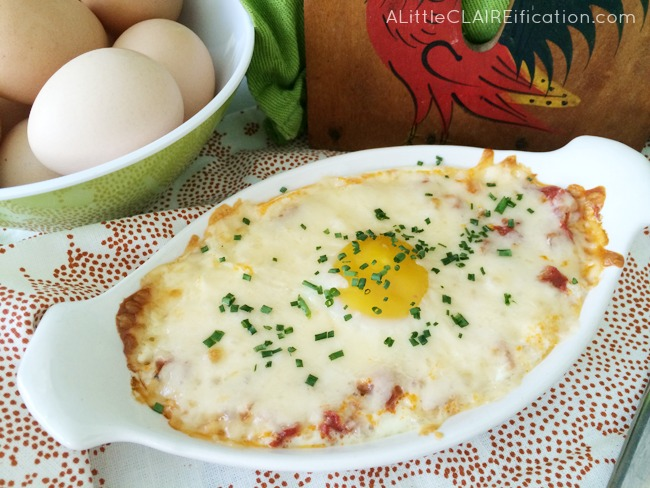 Spanish Eggs Flamenco Recipe - delicious sauce and chorizo covered with a baked egg and melted Manchego cheese.